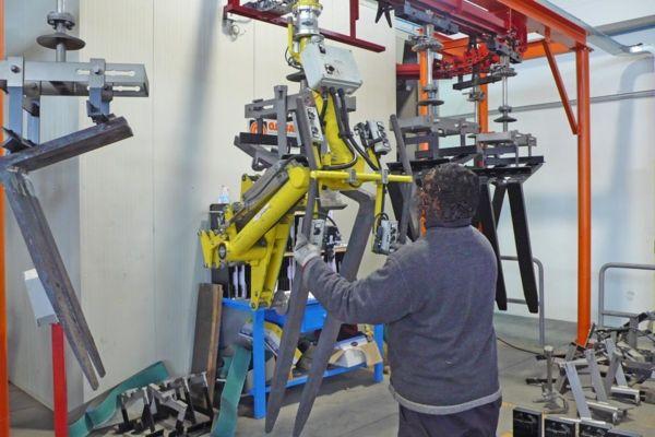 Horquillas carretillas - descarga de línea pintura - Manipulador neumático ATIS