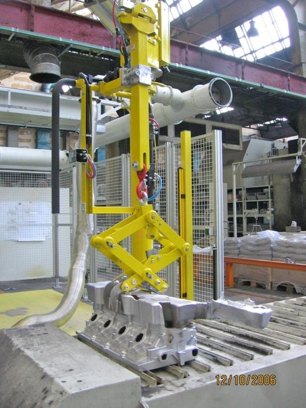 BMW motor foundry scissor gripper - Pneumatic Manipulator ATIS
