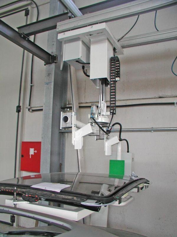 ATISlinear - montaje techo cristal sobre el vehículo - Manipulador neumático ATIS