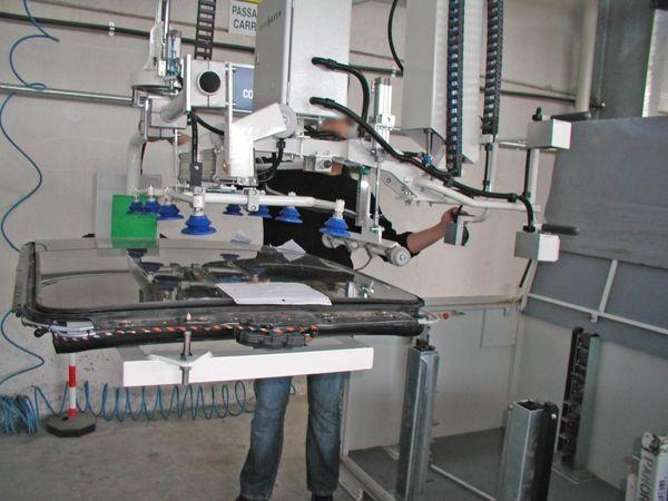Soltado techo cristal sobre 2º implemento - Manipulador neumático ATIS